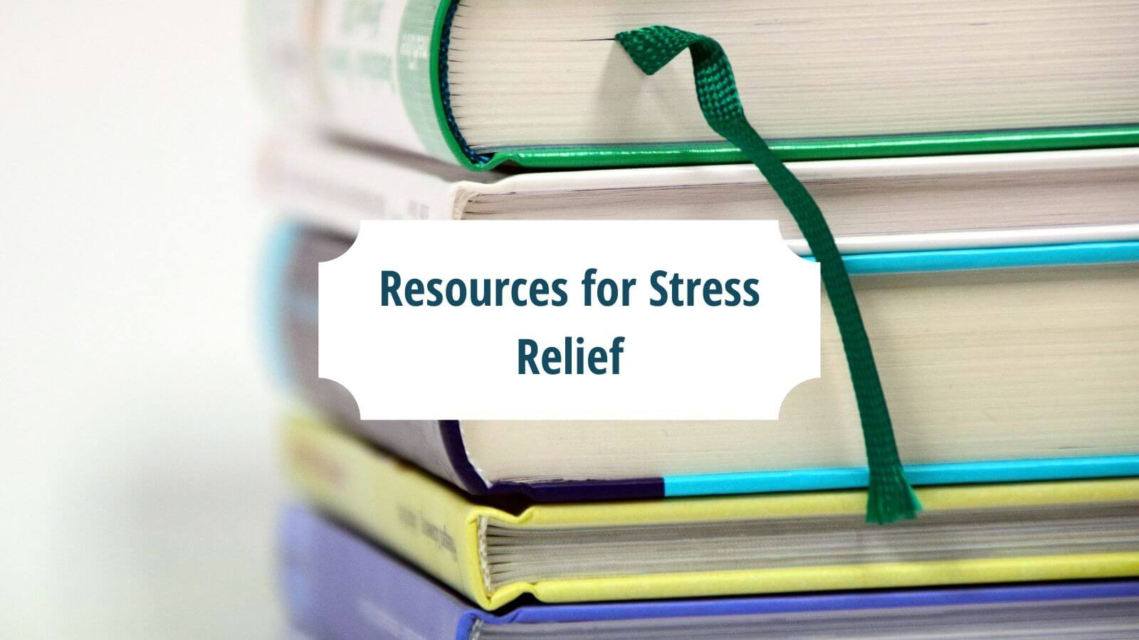 """A stack of books with the words """"Resources for Stress Relief"""" in green against a white block 