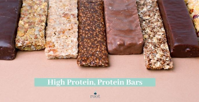 """Chocolate and nut protein bars lined up on a pink background with the words """"high protein, protein bars"""" in white writing against a turquoise banner 
