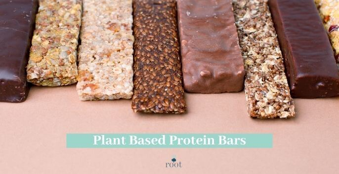 """Chocolate and nut protein bars lined up on a pink background with the words """"plant-based protein bars"""" in white writing against a turquoise banner 