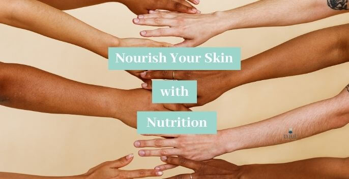 Arms of different races outstretched touching together | Skin Hydration Vitamins | Root Nutrition Education & Counseling