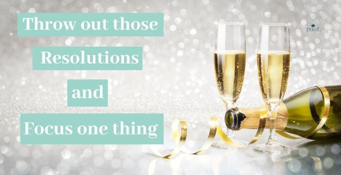 """Champaign Bottle on it's side with two champagne glasses filled and the words """"throw out those resolutions and focus on one thing"""" 