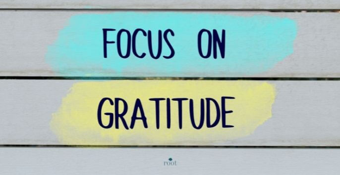 """Wall with the words """"Focus on Gratitude"""" pained in black letters 